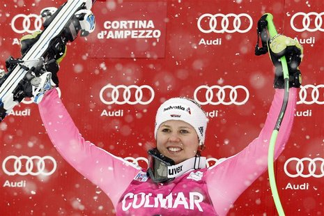 Viktoria Rebensburg of Germany celebrates on the podium after winning the women's Super G event at the Alpine Skiing World Cup in Cortina d'