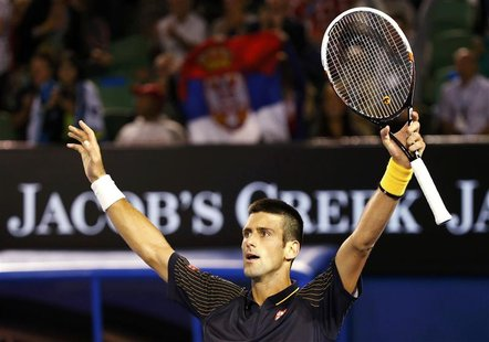 Novak Djokovic of Serbia celebrates defeating Stanislas Wawrinka of Switzerland during their men's singles match at the Australian Open tenn