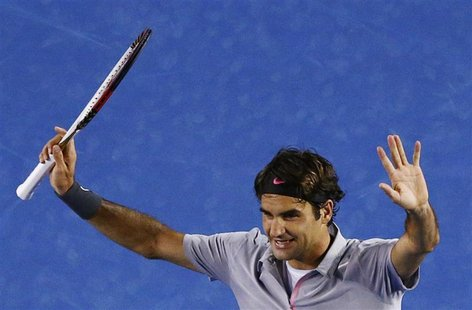 Roger Federer of Switzerland celebrates defeating Bernard Tomic of Australia in their men's singles match at the Australian Open tennis tour