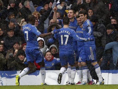 Chelsea's Juan Mata (2nd R) celebrates his goal against Arsenal during their English Premier League soccer match at Stamford Bridge in Londo