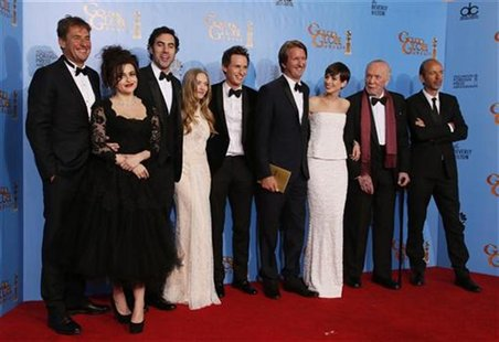 "The Cast of ""Les Miserables"" (From L) producer Tim Bevan, Helena Bonham Carter, Sasha Baron Cohen, Amanda Seyfried, Eddie Redmayne, director"