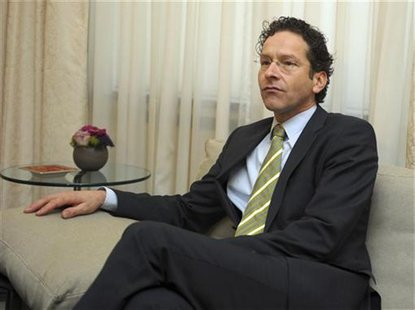 Netherlands' Finance Minister Jeroen Dijsselbloem takes a seat during his meeting with Luxembourg's Prime Minister and Eurogroup Chairman Je