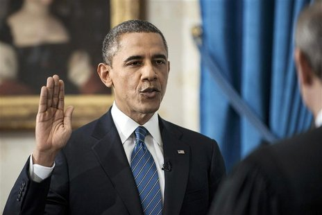 U.S. President Barack Obama takes the official oath of office from U.S. Supreme Court Chief Justice John Roberts, as Obama is sworn in for h