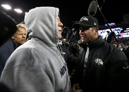 New England Patriots head coach Bill Belichick (L) congradulates Baltimore Ravens head coach John Harbaugh after the Ravens defeated the Pat