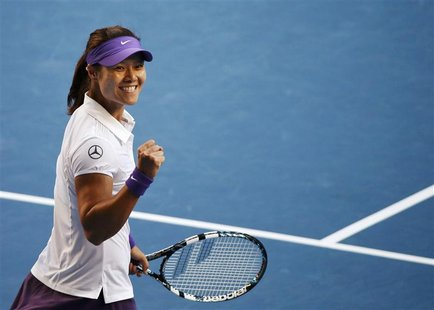 Li Na of China celebrates defeating Julia Goerges of Germany in their women's singles match against at the Australian Open tennis tournament