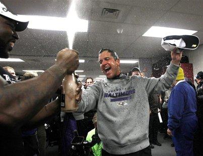 Baltimore Ravens head coach John Harbaugh celebrates in the dressing room after his team defeated the New England Patriots in the NFL AFC Ch