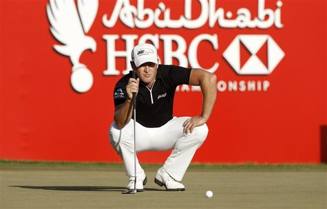 Jamie Donaldson of Wales lines up on the 18th green during the final round of the Abu Dhabi Golf Championship at the Abu Dhabi Golf Club Jan