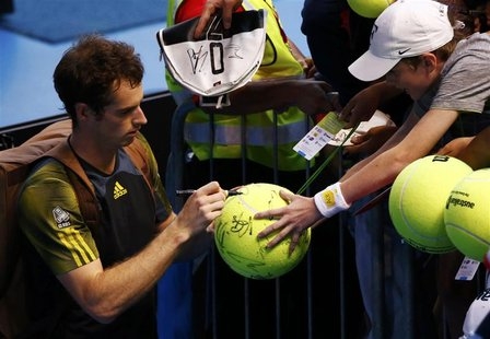 Andy Murray of Britain signs autographs for fans after defeating Gilles Simon of France in their men's singles match at the Australian Open