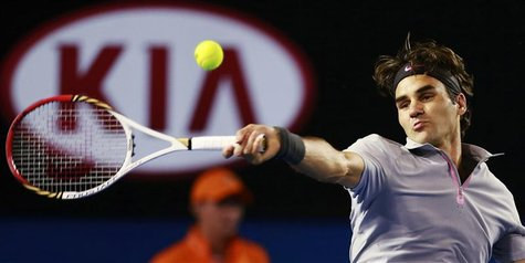 Roger Federer of Switzerland hits a return to Milos Raonic of Canada during their men's singles match at the Australian Open tennis tourname