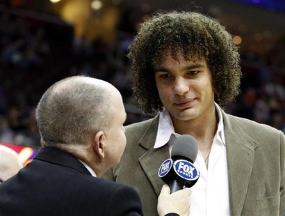 Cleveland Cavaliers Anderson Varejao talks with a TV reporter during the second quarter of the team's NBA basketball game against the Detroi