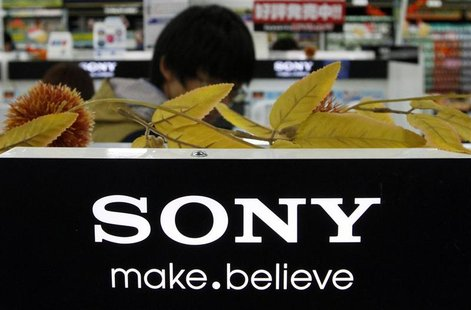 man stands behind Sony Corp's logo at an electronics store in Tokyo