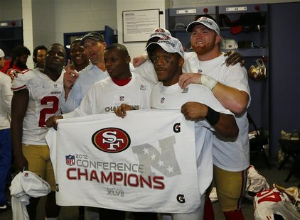 Members of the San Francisco 49ers pose in locker room with NFC championship banner after they defeated the Atlanta Falcons in the NFL NFC C