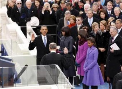 Barack Obama takes the oath of office to begin his second term (Reuters)