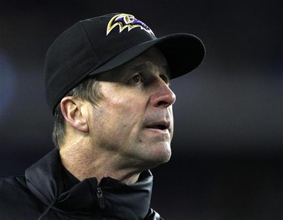Baltimore Ravens head coach John Harbaugh directs his team against the New England Patriots in the NFL AFC Championship football game in Fox