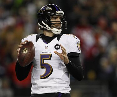 Baltimore Ravens quarterback Joe Flacco looks to pass against the New England Patriots during the NFL AFC Championship football game in Foxb