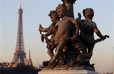 A statue decorates the Alexandre III Bridge which crosses the River Seine near the Eiffel Tower in Paris January 16, 2013. REUTERS/Philippe