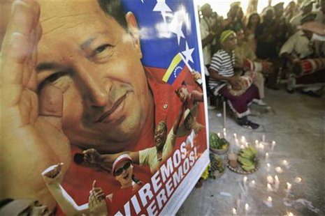 A poster of Venezuela's President Hugo Chavez is seen during a Afro-Cuban Santeria ceremony to pray for his recovery, in Havana January 10,