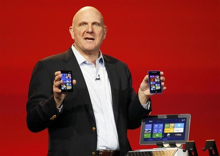 Microsoft CEO Steve Ballmer displays Windows Phone 8 devices at the Qualcomm pre-show keynote at the Consumer Electronics Show (CES) in Las