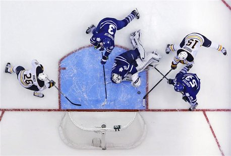 Toronto Maple Leafs goalie Ben Scrivens (30) makes a save on Buffalo Sabres' Cody Hodgson (19) during the third period of their NHL hockey g