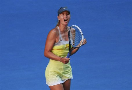 Maria Sharapova of Russia celebrates defeating compatriot Ekaterina Makarova in their women's singles quarter-final match at the Australian