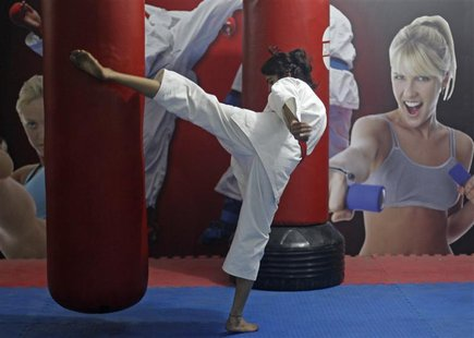 Sweety, 22, a student, takes a self defence class in New Delhi, January 14, 2013. Sweety travels four hours every day from her village to th