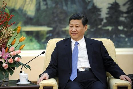 China's Communist Party chief Xi Jinping looks on during his meeting with U.N. General Assembly President Vuk Jeremic at the Great Hall of t