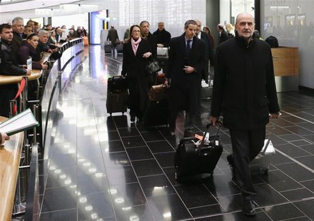 Herman Nackaerts, head of a delegation of the International Atomic Energy Agency (IAEA), pulls his suitcases at the airport in Vienna after