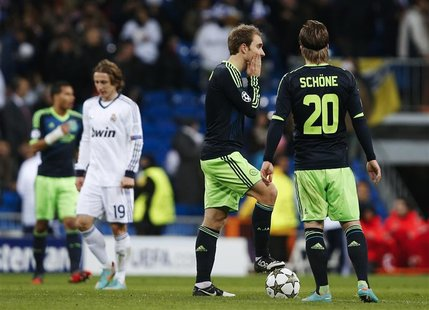 Ajax Amsterdam's Christian Eriksen (L) and Lasse Schone after Real Madrid's fourth goal during their Champions League Group D soccer match a