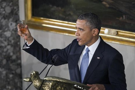 U.S. President Barack Obama raised a glass at the concluded his speech during the Inaugural luncheon in Statuary Hall after his ceremonial s