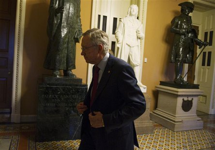 U.S. Senate Majority Leader Harry Reid (D-NV) walks to his office at the U.S. Capitol after returning from a meeting with President Barack O