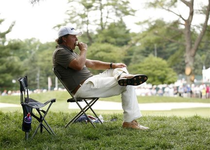 Phil Mickelson of the U.S. takes a break in play on the 15th tee during the second round of the 2011 U.S. Open golf tournament at Congressio