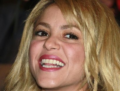 Colombian singer Shakira smiles before being awarded Knight of Arts and Letter by French Culture Minister Frederic Mitterrand (not pictured)