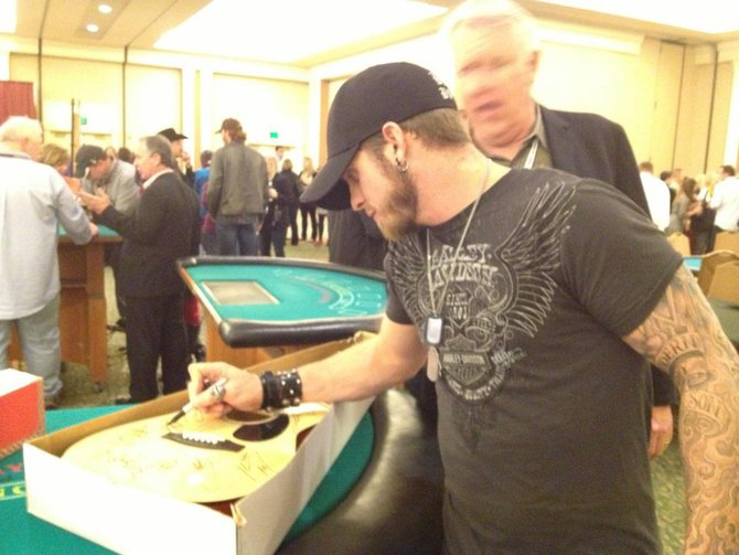 Brantley Gilbert signing the guitar Jess Kelley won for the St. Jude Radiothon. Thanks Brantley!