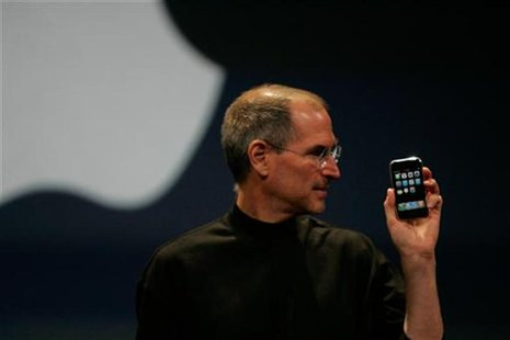 Apple Computer Inc. Chief Executive Officer Steve Jobs holds the new iPhone in San Francisco, California January 9, 2007. REUTERS/Kimberly W