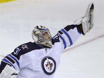 Winnipeg Jets' goalie Ondrej Pavelec makes a save against the Washington Capitals in the third period of their NHL hockey game in Washington
