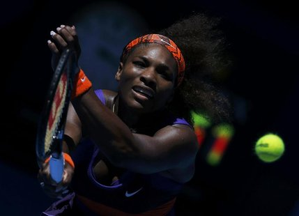 Serena Williams of the U.S. hits a return to compatriot Sloane Stephens during their women's singles quarter-final match at the Australian O