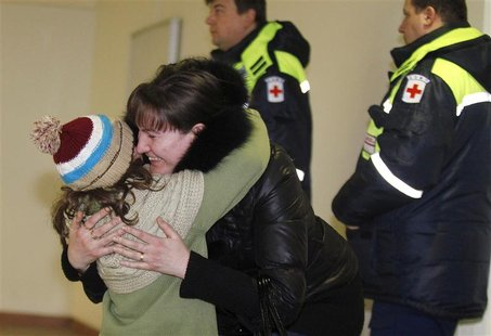 A woman hugs her daughter, who was a passenger on a Russian Emergencies Ministry flight from Beirut, after her arrival at Moscow's Domodedov