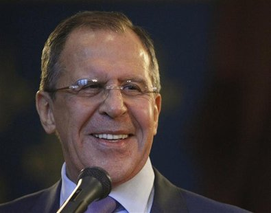 Russia's Foreign Minister Sergei Lavrov smiles during a joint news conference with U.N.-Arab League peace mediator Lakhdar Brahimi of Algeri