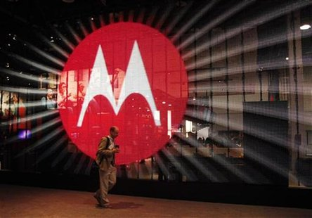 A man walks by a video display at the Motorola booth on the second day of the Consumer Electronics Show (CES) in Las Vegas January 7, 2011.