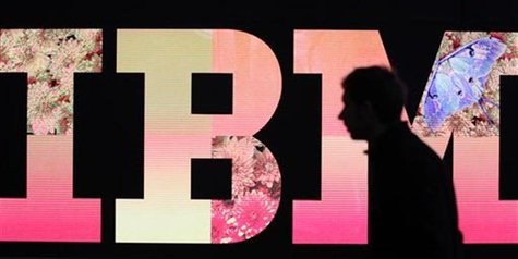 A man passes by an illuminated IBM logo at the CeBIT computer fair in Hanover February 27, 2011. The world's largest IT fair CeBIT opens its