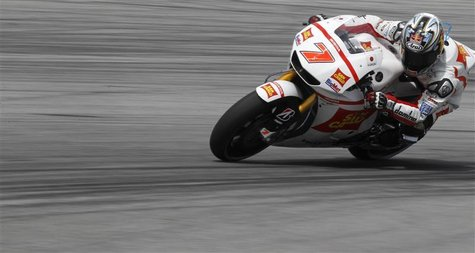 Honda MotoGP rider Hiroshi Aoyama of Japan takes a corner during the third free practice session at the Malaysian Grand Prix at Sepang Inter