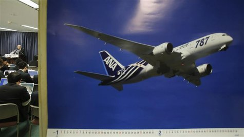 Norihiro Goto, Japan Transport Safety Board chairman, attends a news conference as a calendar displaying a picture of All Nippon Airways' Bo