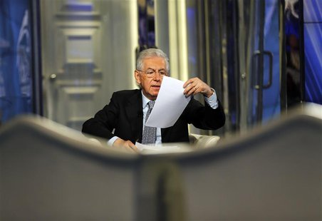 Italy's Prime Minister Mario Monti speaks during an interview as a guest on the RAI television Porta a Porta (Door to Door) in Rome January