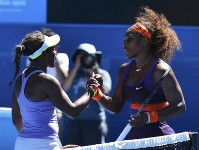 Sloane Stephens of the U.S. shakes hands with compatriot Serena Williams after defeating her in their women's singles quarter-final match at