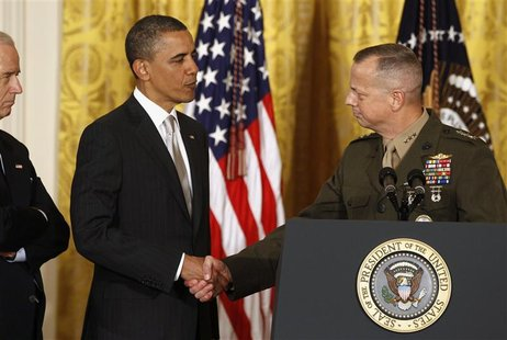 U.S. Marine Lt. Gen. John Allen shakes hands with U.S. President Barack Obama at an event in the East Room of the White House in this April