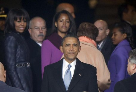 U.S. President Barack Obama turns to look at the crowds gathered on the National Mall as he leaves the podium after his swearing-in ceremoni