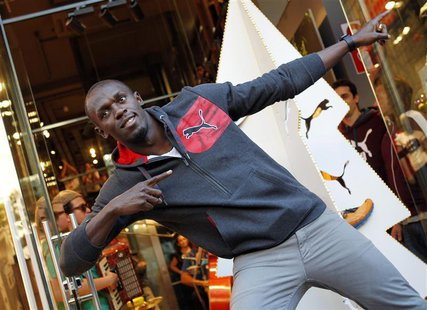 Jamaica's double Olympic champion sprinter Usain Bolt strikes a pose while inaugurating a Puma store in Barcelona November 23, 2012. REUTERS