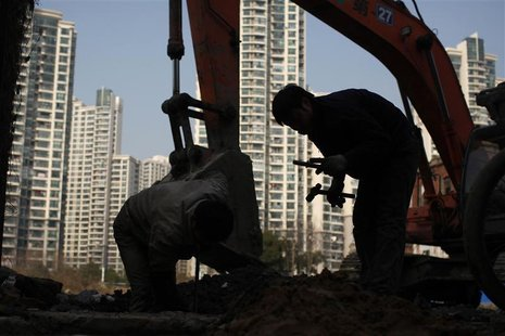 A labourer works at a residential construction site in Shanghai January 18, 2013. REUTERS/Aly Song