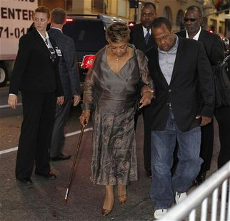 "Cissy Houston, mother of the late singer Whitney Houston, is escorted as she bypasses the red carpet at the premiere of the new film ""Sparkl"