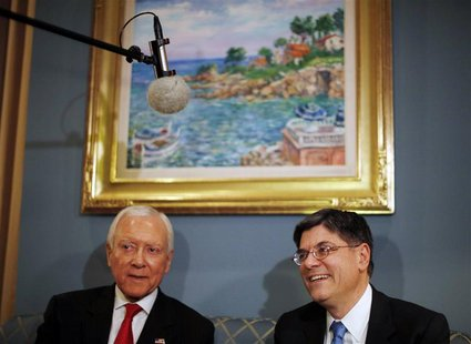 Jack Lew (R), U.S. President Barack Obama's nominee for Treasury Secretary, meets with U.S. Senator Orrin Hatch (R-UT) on Capitol Hill in Wa